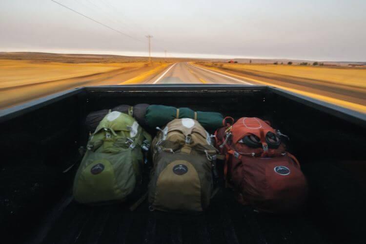 three backpacks