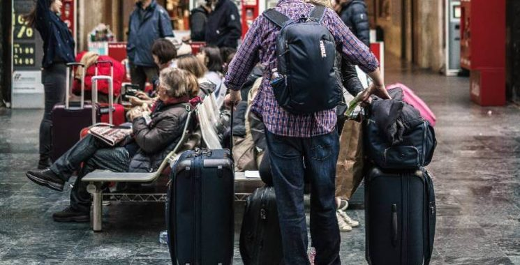 attach backpack to rolling suitcase